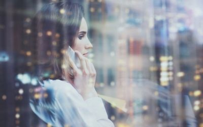Business woman looking out window / Adobe Stock Photo