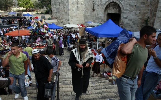 """A scene from the """"Arab Shuk"""" in Jerusalem in 2009. Jews and Muslims shop alongside each other. Getty Images"""