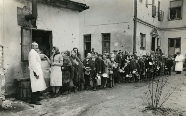 Jews are seen lining up in the Warsaw Ghetto during World War II. (Courtesy of American Jewish Joint Distribution Committee Archives)