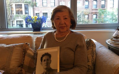 Rose Holm at her Manhattan apartment holding a photo of her late husband, Oct. 31, 2017. (Josefin Dolsten)