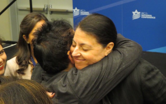 Knesset member Merav Michaeli embracing a participant at the Israeli American Council's annual Washington conference, Nov. 5, 2017. (Ron Kampeas)
