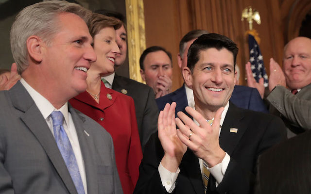House Speaker Paul Ryan, right, and Majority Leader Kevin McCarthy, left, celebrating with fellow House Republicans following the passage of the Tax Cuts and Jobs Act in the Rayburn Room at the U.S. Capitol, Nov. 16, 2017. (Chip Somodevilla/Getty Images)