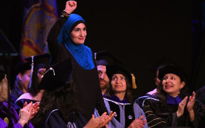 Linda Sarsour speaking at the CUNY Graduate School of Public Health's inaugural commencement ceremony at the Apollo Theatre in New York City, June 1, 2017. (Timothy A. Clary/AFP/Getty Images)