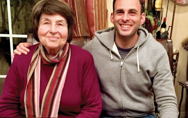 Both Polya Kipnis, left, an immigrant from Ukraine, and the family's 19th-century menorah, have roots in Ukraine. With her is her grandson Michael Zatulovsky. PHOTO COURTESY MILA ZATULOVSKY