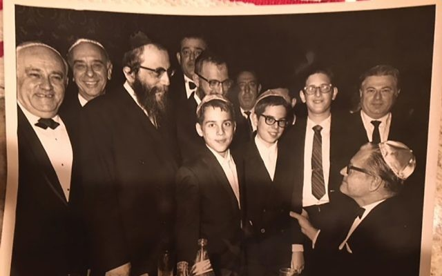 At a fundraising dinner for the Yeshiva of Eastern Parkway, the guest speaker was Gov. Nelson Rockefeller. He is shown holding the arm of Barry Lichtenberg, then in the school's sixth grade. Courtesy ofBarry Lichtenberg