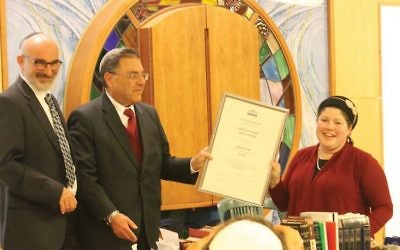 Rabbi Shlomo Riskin, center, presents Rabbanit Shira Zimmerman with her certification as an arbiter of Jewish law at a January ceremony in Jerusalem. Nurit Jacobs Yinon/Aluma films