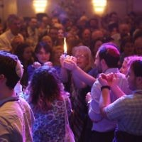 A communal havdalah ceremony at the Limmud Festival in 2017. The festival attracted over 2,000 attendees from across Europe. Courtesy of Limmud