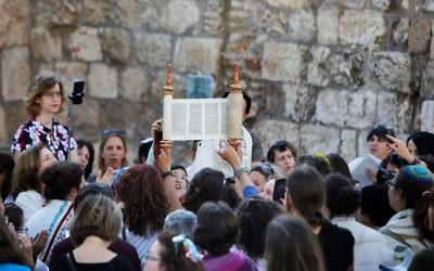 Members of the liberal Jewish religious group Women of the Wall, wearing skullcaps and traditional Jewish prayer shawls known as Tallit, hold up the Torah scroll during a morning prayer marking the first day of the Jewish month of Elul, on August 23, 2017 at the Western Wall in Jerusalem's Old City. Getty Images