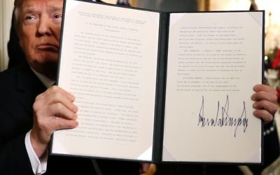 U.S. President Donald Trump holds up a proclamation that the U.S. government will formally recognize Jerusalem as the capital of Israel after signing the document in the Diplomatic Reception Room at the White House December 6, 2017 in Washington, DC. Getty Images