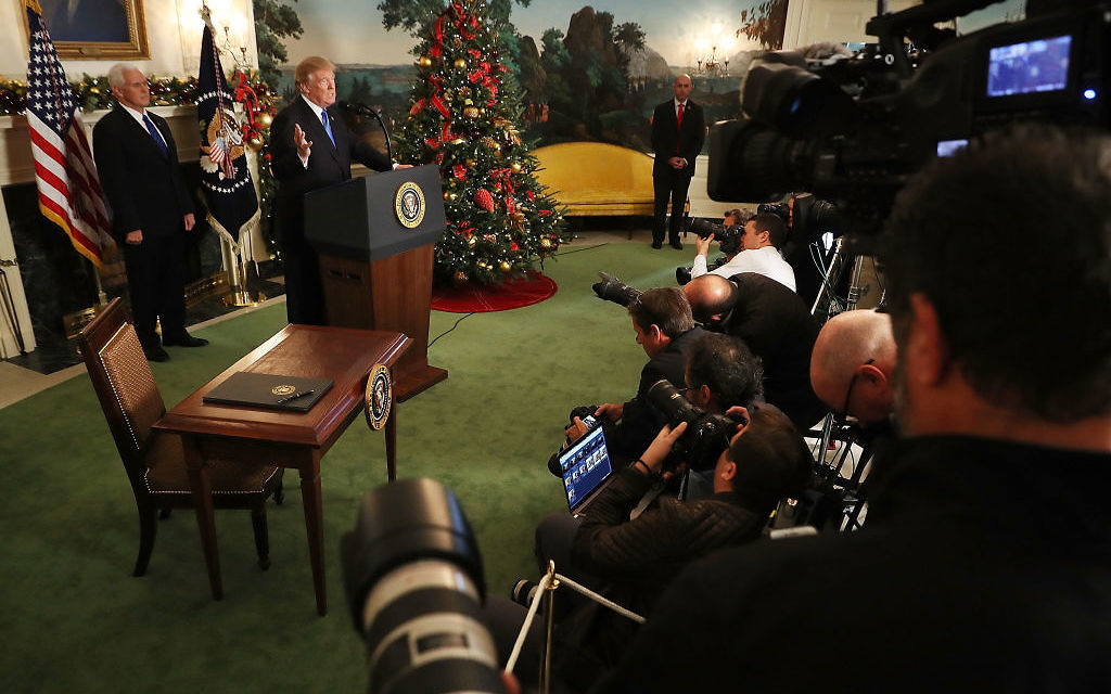 U.S. President Donald Trump announces that the U.S. government will formally recognize Jerusalem as the capital of Israel with Vice President Mike Pence (L) in the Diplomatic Reception Room at the White House December 6, 2017 in Washington, DC. In keeping with a campaign promise, Trump said the United States will move its embassy from Tel Aviv to Jerusalem sometime in the next few years. No other country has its embassy in Jerusalem. Getty Images