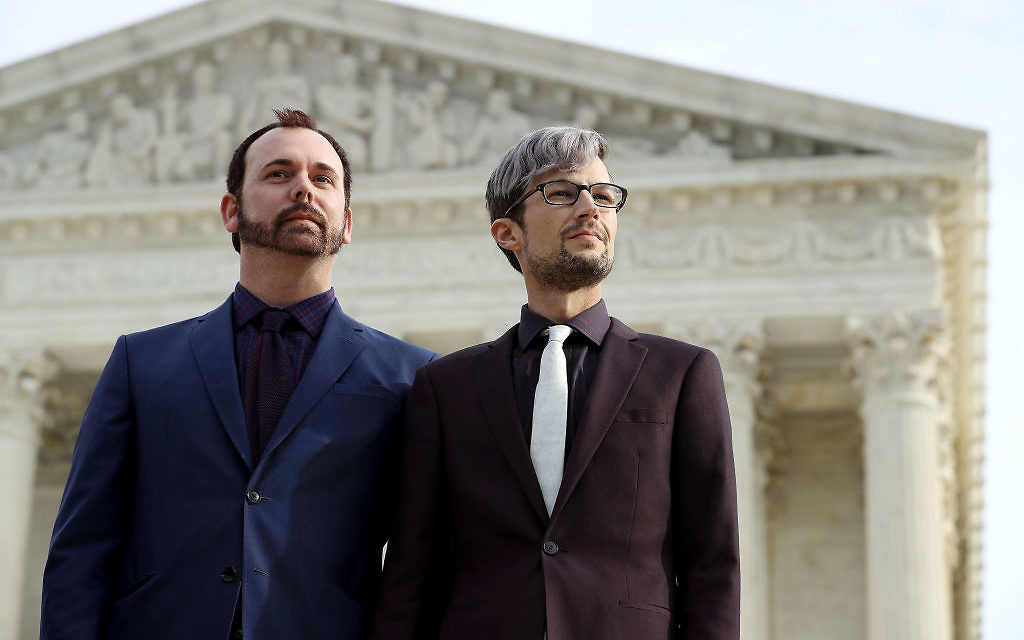 David Mullins (L) and Charlie Craig wait to speak to journalists after the U.S. Supreme Court hear the case Masterpiece Cakeshop v. Colorado Civil Rights Commission December 5, 2017 in Washington, DC. Craig and Mullins filed a complaint with the commission in 2012 after conservative Christian baker Jack Phillips refused to sell them a wedding cake for their same-sex ceremony. Getty Images