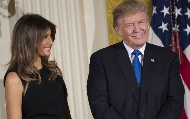US President Donald Trump and First Lady Melania Trump attend a Chanukah reception in the East Room of the White House in Washington, DC, December 7, 2017. Getty Images