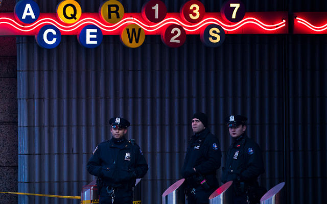 NEW YORK, NY - DECEMBER 11: New York City Police Department officers stand guard at a closed subway station near Times Square and the New York Port Authority Bus Terminal, December 11, 2017 in New York City. The Police Department said that one person was in custody for an attempted terror attack after an explosion in a passageway linking the Port Authority Bus Terminal with the subway. (Photo by Drew Angerer/Getty Images)