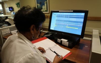 Nursing Manager at Parker Jewish Institute monitors functions at EarlySense central display station.