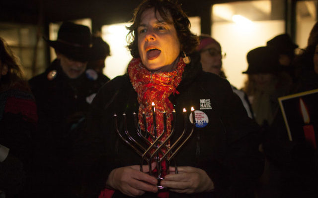 """Rabbi Debra Cantor of Congregation B'nai Tikvoh-Sholom in Bloomfield, Conn., speaking at Trump Tower in Manhattan at the """"Not The White House Chanukah Party,"""" a protest organized by T'ruah, Dec. 13, 2017. JTA"""