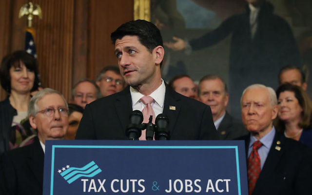 House Speaker Paul Ryan, flanked by Republican lawmakers, speaking at the U.S. Capitol about the Tax Cuts and Jobs Act that was passed this week by the House and Senate, Dec. 21, 2017. (Mark Wilson/Getty Images)