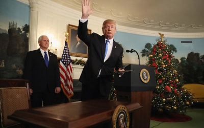 Donald Trump waving to reporters, as Vice President Mike Pence looks on, after announcing that the U.S. government will formally recognize Jerusalem as the capital of Israel in the Diplomatic Reception Room at the White House, Dec. 6, 2017. JTA