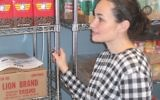 Mindy Nisanov, coordinator of the Food Pantry at the Central Queens Y, looks over her supply of food.  STEVE LIPMAN/JW