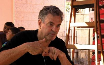 "Amos Gitai on the set of ""West of the Jordan,"" which marks his return to the West Bank in more than 30 years since ""Field Diary."" Photos courtesy of Kino Lorber"
