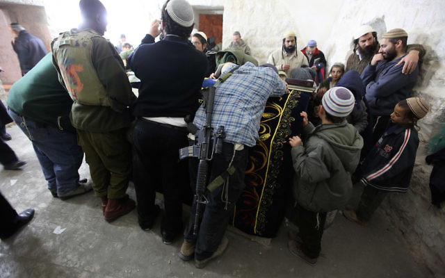 Jewish settlers praying in Joseph's Tomb in the West Bank city of Nablus, Dec. 28, 2010. (Kobi Gideon / Flash90)