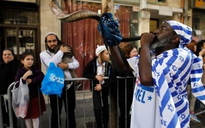 A Christian pilgrim blows the Shofar (an ancient musical horn made of ram's horn) during the annual support march for Israel in Jerusalem on the occasion of the Sukkot holiday (Tabernacles), organised by the International Christian Embassy and the Jerusalem municipality, on October 10, 2017. Thousands of Christian pilgrims from around the globe took to the streets of Jerusalem in a colorful show of support for Israel. Most of those gathered are Evangelical Christians whose bond with Israel is rooted in their shared biblical covenant between God and Abraham, said David Parsons, a spokesman for the ICEJ. Getty Images