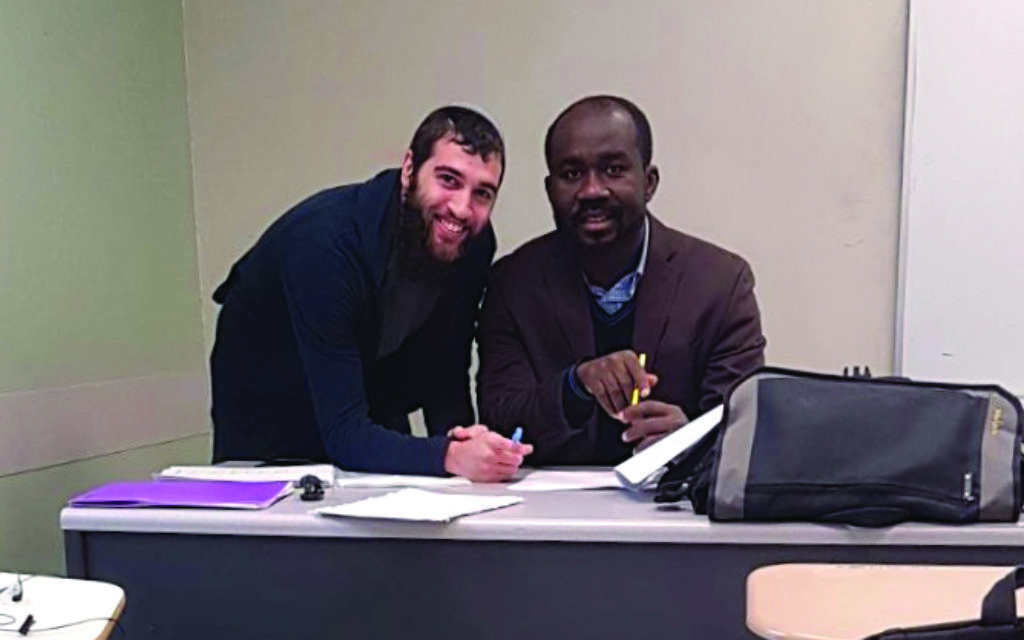 Boruch Wilansky, left, with his math lecturer, Samuel Antwi-Agyei, who is from Ghana. Courtesy of Boruch Wilansky