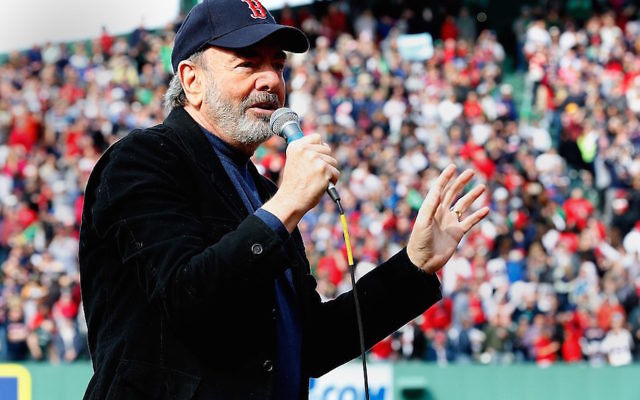 """Neil Diamond singing """"Sweet Caroline"""" during a Boston Red Sox game at Fenway Park in the weeks after the Boston Marathon bombing, April 20, 2013. (Jim Rogash/Getty Images)"""