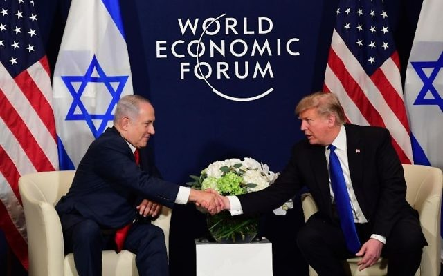 Israeli Prime Minister Benjamin Netanyahu and U.S. President Donald Trump meet in Davos, Switzerland on the sidelines of the World Economic Forum. (GPO/Amos Ben-Gershom)