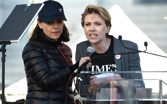 Jewish actresses Scarlett Johansson, right, and Mila Kunis speak onstage at the 2018 Women's March Los Angeles at Pershing Square on Jan. 20, 2018. JTA