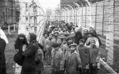Liberation of children from Auschwitz-Birkenau, with adult female relief workers who were pixelated in Mishpacha magazine, January 24, 2018 issue.  Twitter/@religion_state