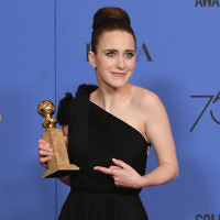 Actor Rachel Brosnahan poses with her award for Best Performance by an Actress in a Television Series Musical or Comedy for 'The Marvelous Mrs. Maisel' in the press room during The 75th Annual Golden Globe Awards at The Beverly Hilton Hotel on January 7, 2018 in Beverly Hills, California. Getty Images