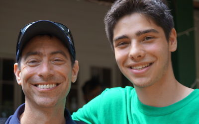 Bruce Steinberg, left, with son William at the Seeds of Peace Camp in Otisfield, Maine. JTA
