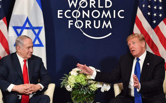 President Donald Trump, right, speaking with Israel's Prime Minister Benjamin Netanyahu during a bilateral meeting on the sidelines of the World Economic Forum in Davos, Switzerland, Jan. 25, 2018. (Nicholas Kamm/AFP/Getty Images)