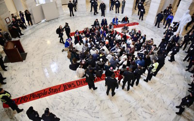 Jewish protesters link arms in a Senate office building asking for protections for undocumented immigrants who arrived as children, Jan. 17 2018. (Religious Action Center of Reform Judaism)