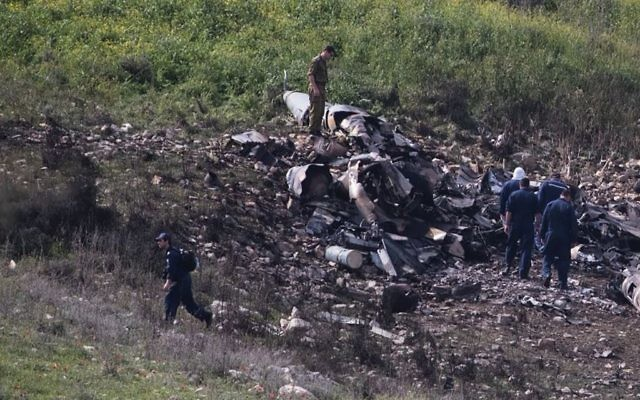 Remains of an Israeli F-16 fighter jet downed by Syrian anti-aircraft missiles. The image was seared into Israelis' consciousness. JTA