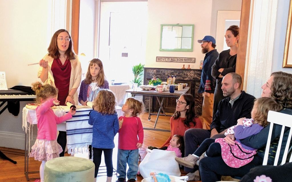 As Rabbi Sara Luria chants the week's Torah portion, children alternate between participating in the service and games with a babysitter, giving parents room to focus on their own spiritual growth. Amy Sara Clark/JW
