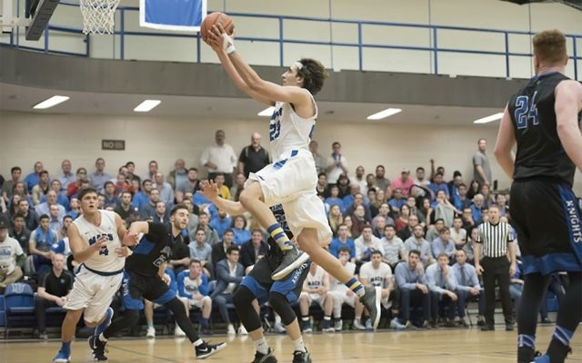 Guard Ben Alluf drives to the basket in Skyline Conference semifinal game against Mount Saint Mary's. YESHIVA UNIVERSITY