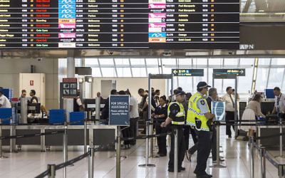 Police guarding the passenger security check area at Sydney Airport, July 30, 2017. (Brook Mitchell/Getty Images)