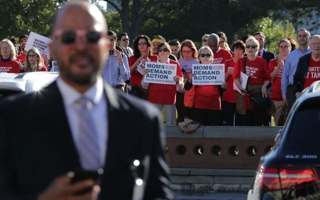 nti-gun violence activists from Moms Demand Action stand at a distance as House Democrats rally on the East Front steps of the U.S. House of Representatives October 4, 2017 in Washington, DC. Getty Images