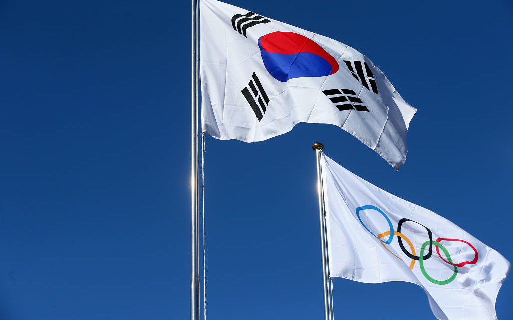 The national flag of Korea is pictured with the Olympic flag during  the PyeongChang 2018 Olympic Village opening ceremony at the PyeongChang 2018 Olympic Village Plaza on February 1, 2018 in Pyeongchang-gun, South Korea. Getty Images