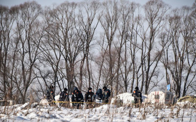 Russian Emergency Ministry rescuers work at the site of a plane crash in Ramensky district, on the outskirts of Moscow on February 12, 2018. Getty Images