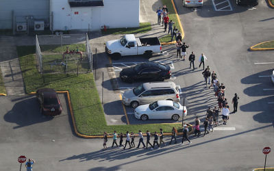 People leaving Marjory Stoneman Douglas High School in Parkland, Fla., after a shooting there on Feb. 14, 2018. Getty Images