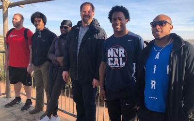 From left: NFL players Mitch Schwartz, Vic Beasley, Josh Norman, Geoff Schwartz, Avery Williamson and Chris Harris Jr. (WestRay Communications)
