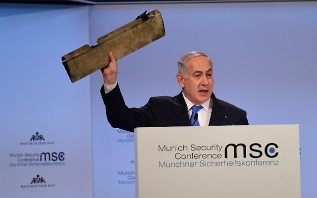 Israeli Prime Minister Netanyahu waves a piece of an Iranian drone shot down over northern Israel during an address to the Munich Security Conference on Feb. 18, 2018. JTA