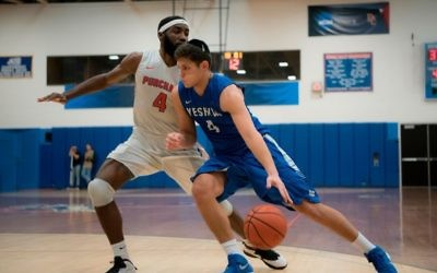 Sophomore Gabriel Leiter of the Yeshiva University Maccabees takes on a player from Purchase College during the team's championship victory on Feb. 25, 2018, which earned an automatic qualification into the NCAA tournament. (Courtesy Yeshiva University)