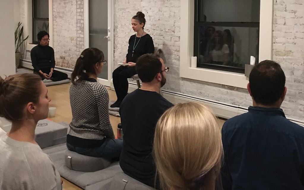 Yael Shy leads a meditation practice at MNDFL in NYC. Courtesy of Yael Shy
