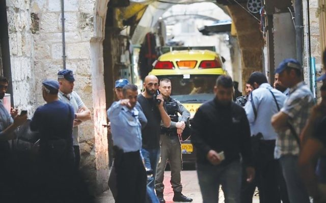 Security personnel at the scene of a stabbing attack Sunday that killed  a civilian Israeli security guard in Jerusalem's Old City. Yonatan Sindel/Flash 90