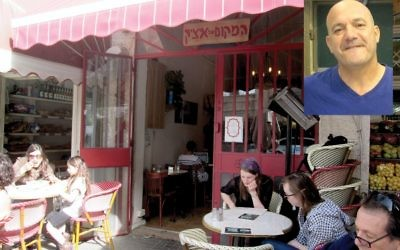 Jerusalem's popular Itzhik's café, above. Left, Uri Ohayon, who owns a Zabar's-type shop.  Photos by Michele Chabin