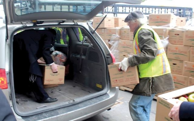 Loading Passover items for needy New Yorkers. Three Upper East Side synagogues join in new effort. Courtesy of Met Council