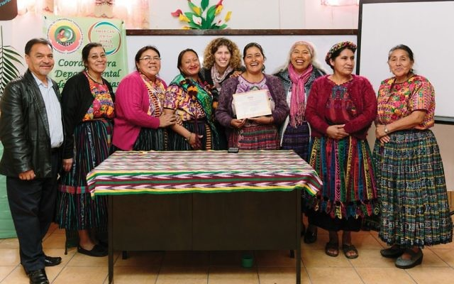 The author, center, presents the midwives of AJWS grantee CODECOT with a plaque for their work to provide holistic care to indigenous women. Christine Han